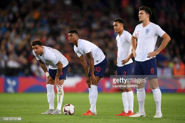 Kyle Walker Marcus Rashford Trent AlexanderArnold and Harry Maguire of England assess a free kick during the international friendly match between...