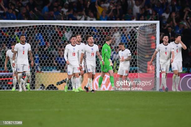 Kyle Walker, Mason Mount, Kalvin Phillips and Declan Rice of England look dejected after the Italy first goal scored by Leonardo Bonucci during the...
