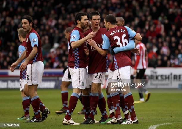 Kyle Walker of Aston Villa celebrates scoring the opening goal with teammates during the FA Cup sponsored by EON 3rd Round match between Sheffield...