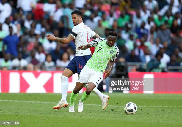 Kyle Walker of England and Ahmed Musa of Nigeria during the International Friendly between England and Nigeria at Wembley Stadium on June 2 2018 in...