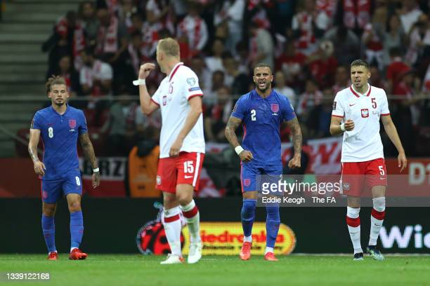 Kyle Walker of England and Kamil Glik of Poland clash during the 2022 FIFA World Cup Qualifier match between Poland and England at Stadion Narodowy...