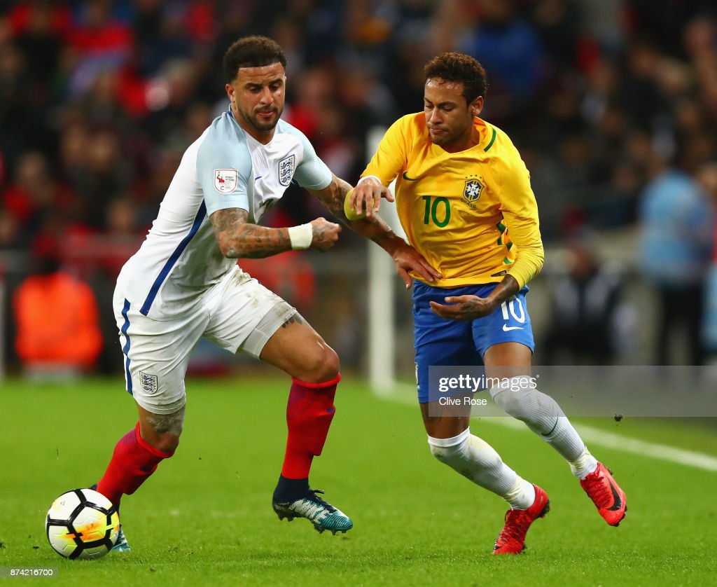 Kyle Walker of England and Neymar Jr of Brazil battle for possession during the international friendly match between England and Brazil at Wembley Stadium on November 14, 2017 in London, England.