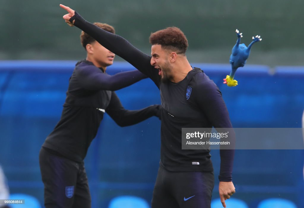 Kyle Walker of England catches a toy chicken during the England training session on July 10, 2018 in Saint Petersburg, Russia.