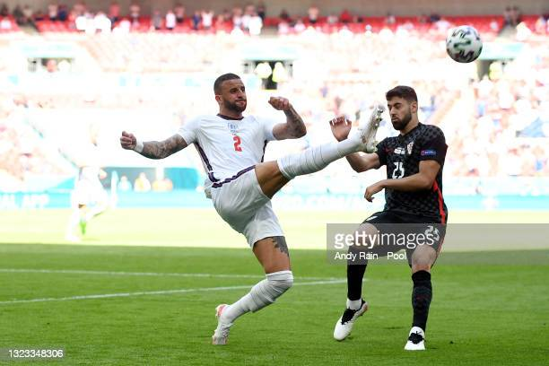 Kyle Walker of England clears the ball whilst under pressure from Josko Gvardiol of Croatia during the UEFA Euro 2020 Championship Group D match...