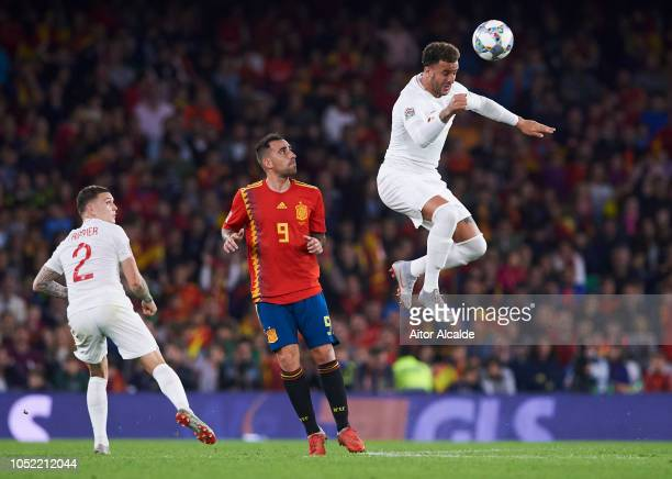 Kyle Walker of England duels for the ball with Paco Alcacer of Spain during the UEFA Nations League A Group Four match between Spain and England at...