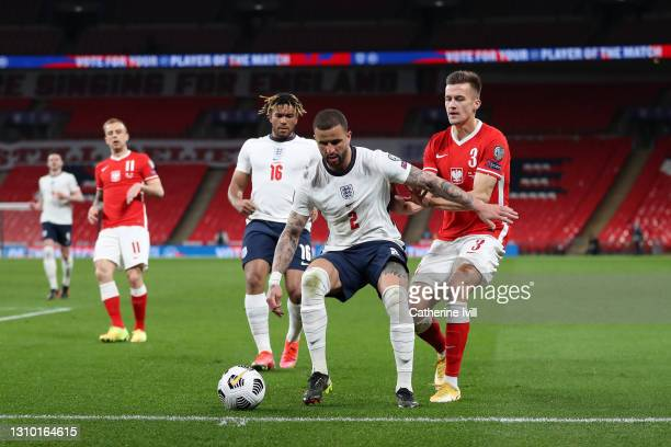 Kyle Walker of England holds off Arkadiusz Reca of Poland during the FIFA World Cup 2022 Qatar qualifying match between England and Poland on March...