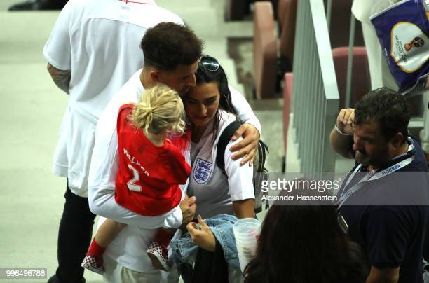 Kyle Walker of England hugs his wife Annie Kilner and his daughter following the 2018 FIFA World Cup Russia Semi Final match between England and...