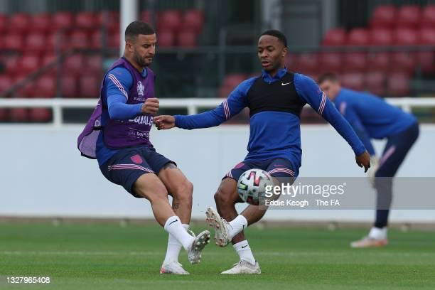 Kyle Walker of England in action with teammate Raheem Sterling during the England Training Session at St George's Park on July 10, 2021 in Burton...