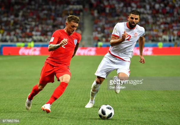 Kyle Walker of England is challenged by Syam Ben Youssef of Tunisia during the 2018 FIFA World Cup Russia group G match between Tunisia and England...