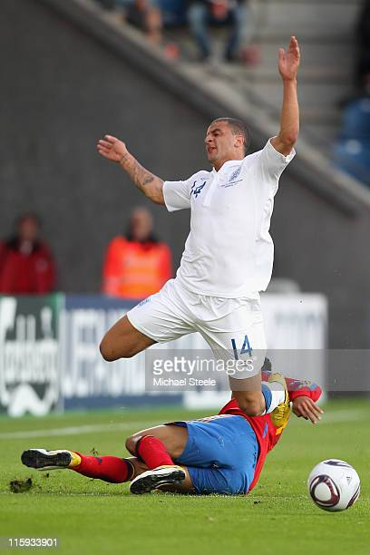 Kyle Walker of England is fouled by Thiago Alcantara of spain during the UEFA European Under21 Championship Group B match between England and Spain...