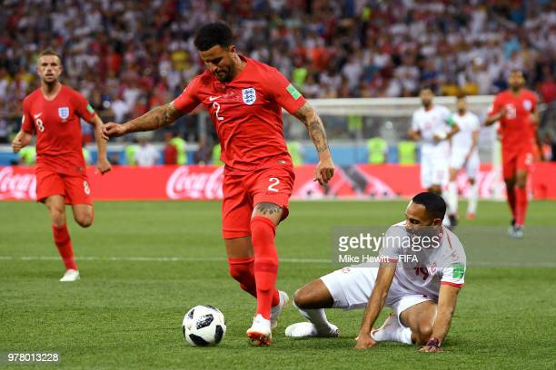 Kyle Walker of England is tackled by Saber Khalifa of Tunisia during the 2018 FIFA World Cup Russia group G match between Tunisia and England at...