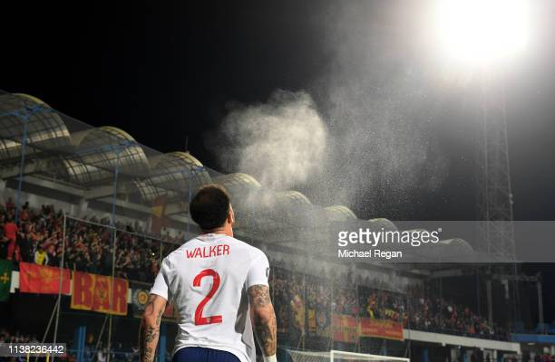 Kyle Walker of England sprays water from his mouth prior to the 2020 UEFA European Championships Group A qualifying match between Montenegro and...