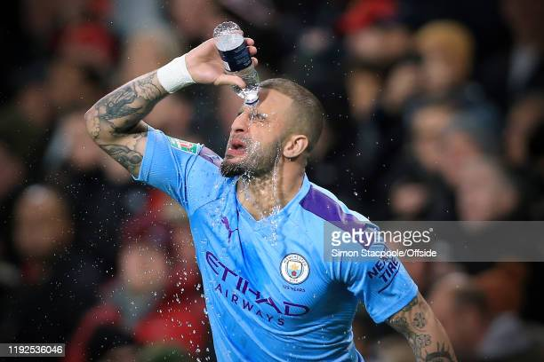 Kyle Walker of Man City pours water over his face before the Carabao Cup Semi Final match between Manchester United and Manchester City at Old...