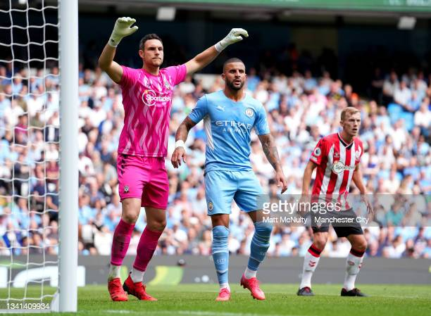 Kyle Walker of Manchester City and Alex McCarthy of Southampton during the Premier League match between Manchester City and Southampton at Etihad...