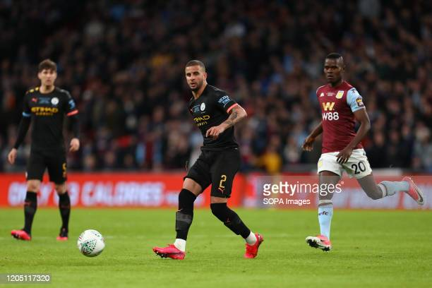 Kyle Walker of Manchester City and Mbwana Samatta of Aston Villa in action during the Carabao Cup Final match between Aston Villa and Manchester City...