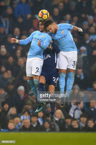 Kyle Walker of Manchester City and Nicolas Otamendi of Manchester City win a header over Christian Eriksen of Tottenham Hotspur during the Premier...