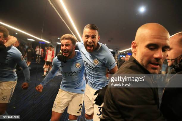 Kyle Walker of Manchester City and Nicolas Otamendi of Manchester City celebrates victory after the Premier League match between Manchester City and...