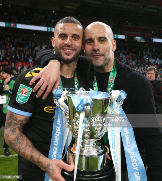 Kyle Walker of Manchester City and Pep Guardiola Manager of Manchester City pose with the trophy following their sides victory in the Carabao Cup...