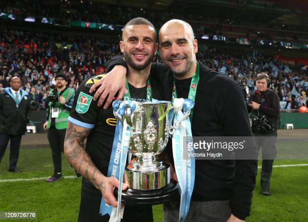 Kyle Walker of Manchester City and Pep Guardiola, Manager of Manchester City pose with the trophy following their sides victory in the Carabao Cup...
