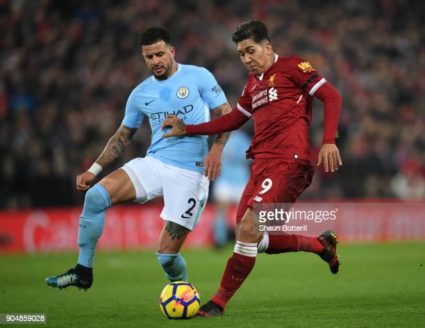 Kyle Walker of Manchester City and Roberto Firmino of Liverpool battles for possesion during the Premier League match between Liverpool and...