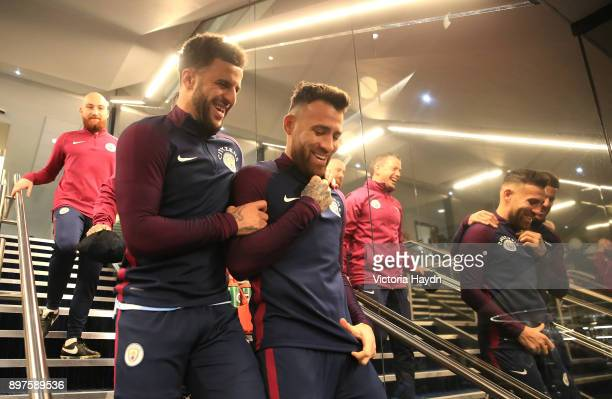 Kyle Walker of Manchester City and teammate Nicolas Otamendi of Manchester City walk out to the pitch to warm up prior to during the Premier League...