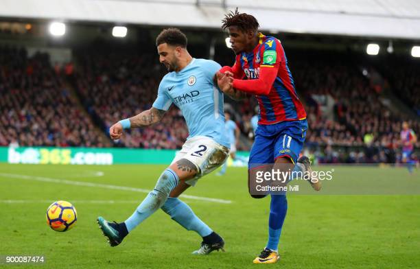Kyle Walker of Manchester City and Wilfried Zaha of Crystal Palace during the Premier League match between Crystal Palace and Manchester City at...