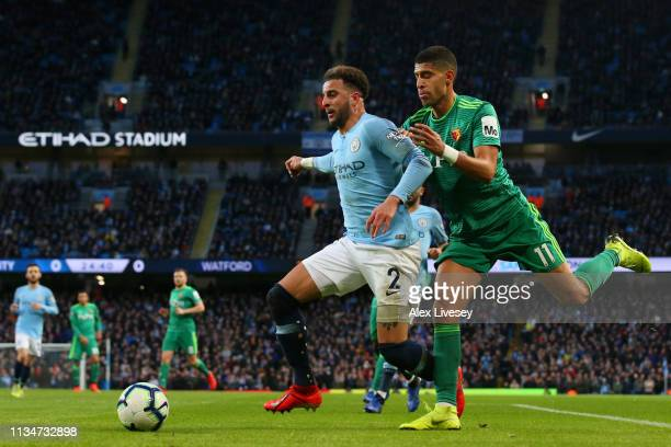 Kyle Walker of Manchester City battles for possession with Adam Masina of Watford during the Premier League match between Manchester City and Watford...