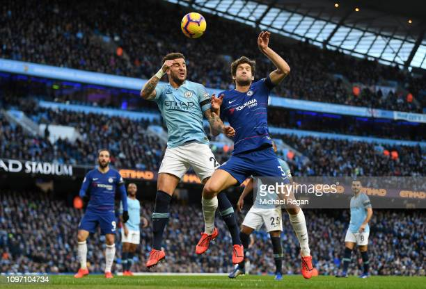 Kyle Walker of Manchester City battles for possession with Marcos Alonso of Chelsea during the Premier League match between Manchester City and...