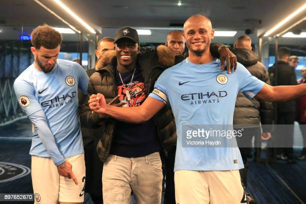 Kyle Walker of Manchester City Benjamin Mendy of Manchester City and Vincent Kompany of Manchester City celebrate victory in the tunnel after the...
