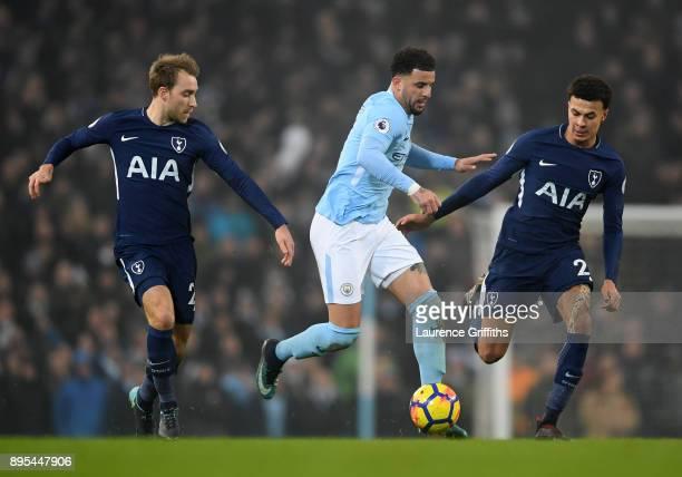 Kyle Walker of Manchester City breaks past Christian Eriksen and Dele Alli of Tottenham Hotspur during the Premier League match between Manchester...