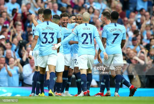 Kyle Walker of Manchester City celebrates after scoring his team's second goal with his team mates during the Premier League match between Manchester...
