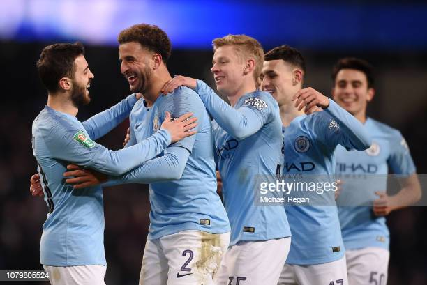 Kyle Walker of Manchester City celebrates after scoring his team's eighth goal with Bernardo Silva and Oleksandr Zinchenko and team mates during the...