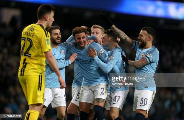Kyle Walker of Manchester City celebrates after scoring his team's eighth goal with team mates during the Carabao Cup Semi Final First Leg match...