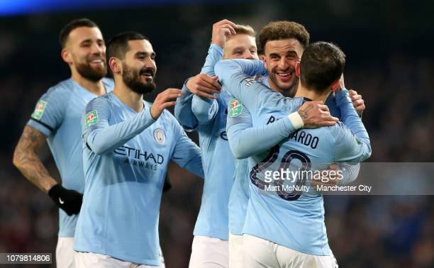 Kyle Walker of Manchester City celebrates after scoring his team's eighth goal with Bernardo Silva Ilkay Gundogan Nicolas Otamendi and Oleksandr...