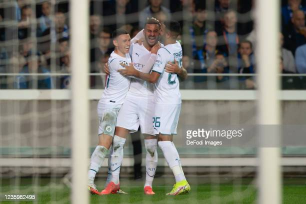 Kyle Walker of Manchester City celebrates after scoring his team's second goal with teammates during the UEFA Champions League group A match between...