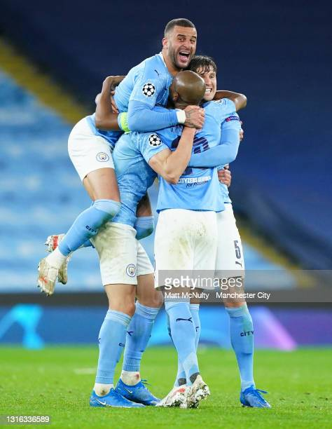 Kyle Walker of Manchester City celebrates victory with Fernandinho, Ruben Dias and John Stones after the UEFA Champions League Semi Final Second Leg...