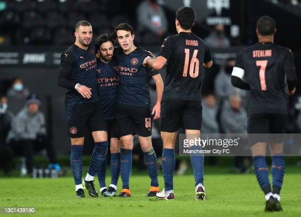Kyle Walker of Manchester City celebrates with Ilkay Gundogan and Eric Garcia after scoring his team's first goal during The Emirates FA Cup Fifth...