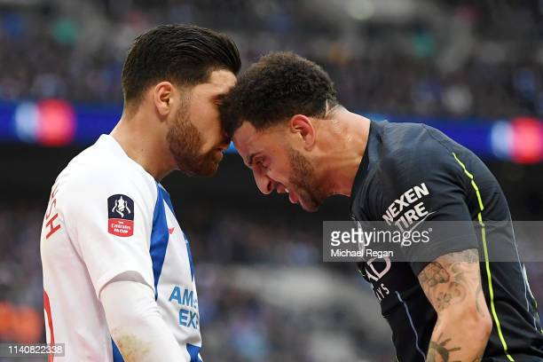 Kyle Walker of Manchester City clashes with Alireza Jahanbakhsh of Brighton and Hove Albion during the FA Cup Semi Final match between Manchester...