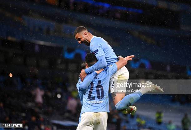 Kyle Walker of Manchester City congratulates Riyad Mahrez of Manchester City on scoring his team's second goal during the UEFA Champions League Semi...