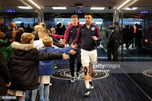 Kyle Walker of Manchester City high fives mascots in tunnel ahead of the Premier League match between Manchester City and Newcastle United at Etihad...