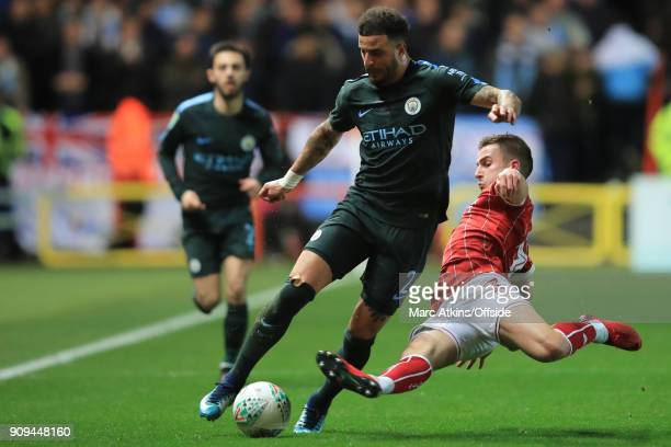 Kyle Walker of Manchester City in action with Joe Bryan of Bristol City during the Carabao Cup SemiFinal 2nd leg match between Bristol City and...