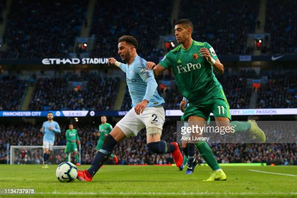 Kyle Walker of Manchester City is challenged by Adam Masina of Watford during the Premier League match between Manchester City and Watford FC at...