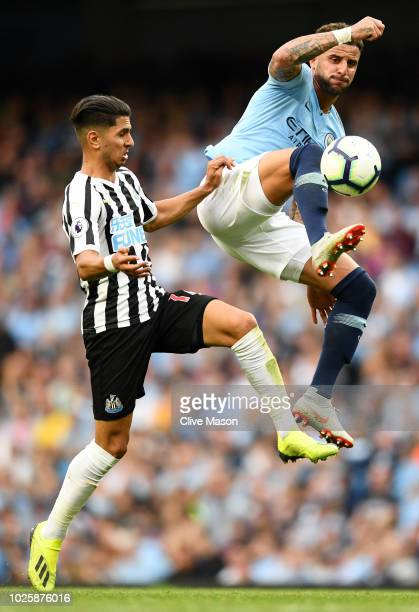 Kyle Walker of Manchester City is challenged by Ayoze Perez of Newcastle United during the Premier League match between Manchester City and Newcastle...