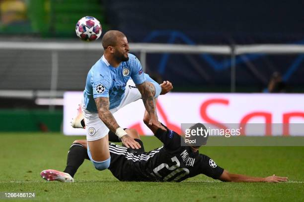 Kyle Walker of Manchester City is challenged by Fernando Marcal of Olympique Lyon during the UEFA Champions League Quarter Final match between...