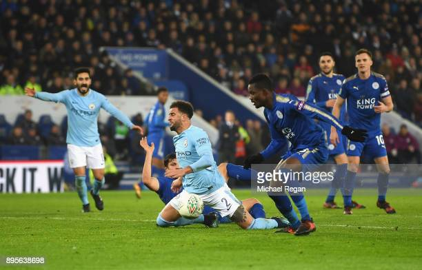 Kyle Walker of Manchester City is challenged by Harry Maguire of Leicester City during the Carabao Cup QuarterFinal match between Leicester City and...