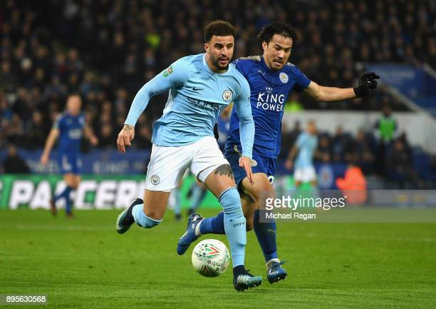 Kyle Walker of Manchester City is chased by Shinji Okazaki of Leicester City during the Carabao Cup QuarterFinal match between Leicester City and...