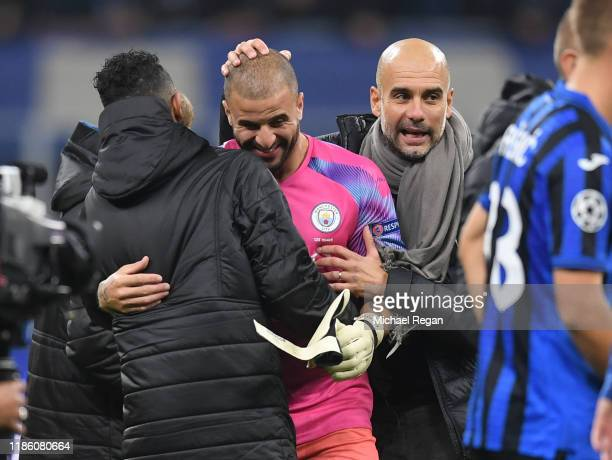 Kyle Walker of Manchester City is congratulated by Pep Guardiola Manager of Manchester City after being substituted on to replace Claudio Bravo in...