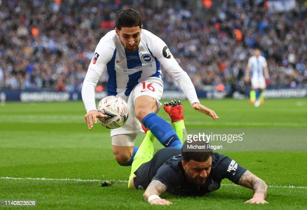 Kyle Walker of Manchester City is fouled by Alireza Jahanbakhsh of Brighton and Hove Albion during the FA Cup Semi Final match between Manchester...