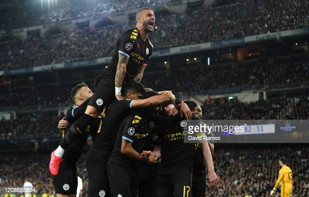 Kyle Walker of Manchester City joins in as Kevin De Bruyne of Manchester City celebrates with teammates after scoring his team's second goal during...
