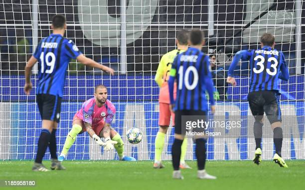 Kyle Walker of Manchester City makes a save while he is in goal for Claudio Bravo of Manchester City who was shown the red card during the UEFA...